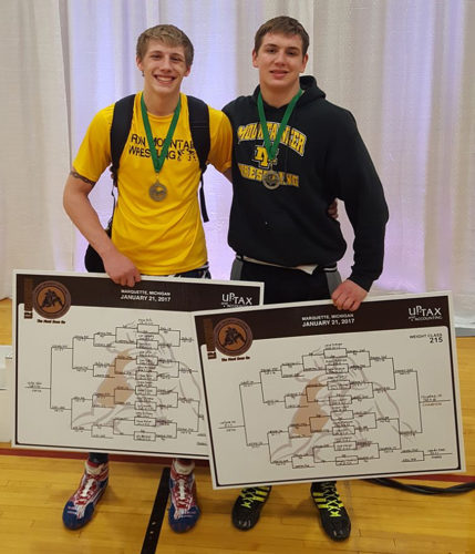 Iron Mountain seniors Aaron Bolo (left) and Braydon Fitzpatrick won wrestling titles Saturday in the U.P. Championships. (Submitted Photo)