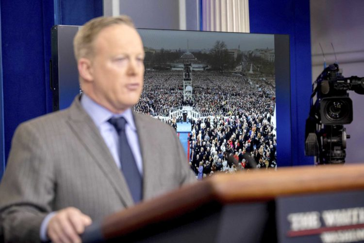 WHITE HOUSE PRESS secretary Sean Spicer speaks at the White House on Saturday in front of an image of President Donald Trump's inauguration. (AP Photo/Andrew Harnik)