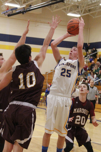 Kingsford's Cory Cootware (25) shoots against Menominee on Monday in Kingsford. (Adam Niemi/The Daily News)