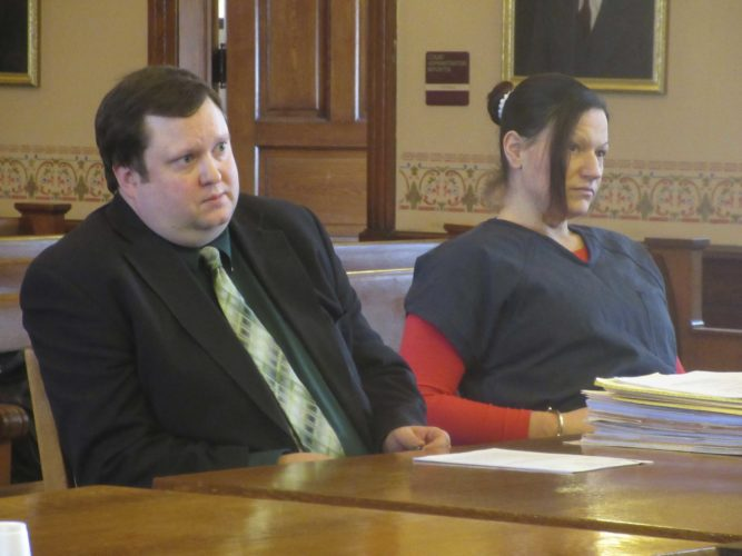 KELLY COCHRAN, RIGHT, awaits a hearing Monday in Iron County Trial Court on a proposed plea deal and motion to change trial venue. Cochran declined the deal, and attorneys will argue over a possible change of venue Thursday. At left is defense attorney Michael Scholke. (Nikki Younk/Daily News photo)