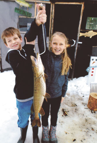 Lucas Thomas, 10, and Alivia Nord, 10, both of Norway, landed a 27-inch northern pike through the ice in Dickinson County.