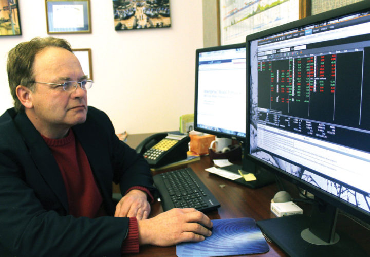 Theresa Proudfit/Daily News Photo  STEVE SANTINI, A financial planner with Ameriprise Financial in Iron Mountain, looks over some market indicators while working on a financial plan. As an adviser for the past 22 years, he enjoys helping people meet their financial goals so they have enough money to last them through their lifetime.