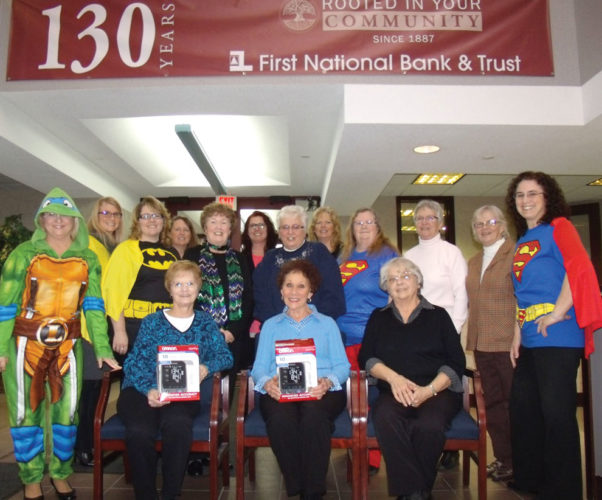 BLOOD DONORS FROM the First National Bank & Trust, shown in front from left, include Pat Clarke, Dorleen Uhazie, and Verna Pollock. In the second row from left are Sandy Meier, Tanya DalSanto, Diane Aune, Caren Erickson, Donna Munn, Sue LaDuc, Mim Christensen, and Jean O'Dette.   In back from left are Lisa Bosley, Mary Wenzel, Spring Porthouse, and Sandy Petroff.