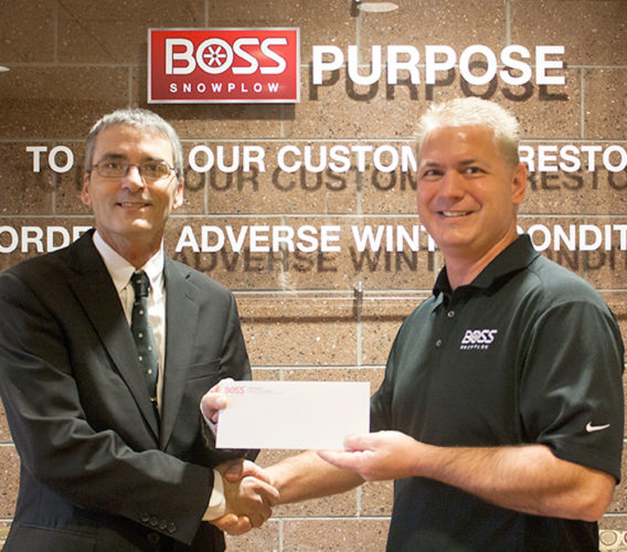 Chris DeRoche, left, a member of the United Way Board, accepts the donation of $3,000 for the annual campaign from Jody Christy, president of BOSS