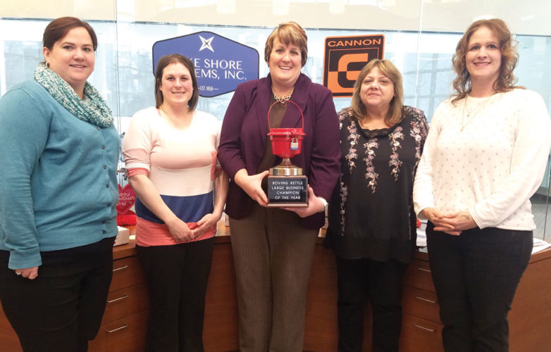 Lake Shore Systems Inc. received the large business traveling trophy from the Salvation Army for raising donations through the Roving Kettle. In the left photo, from left, are Kerstin Trulock and Lena Bartels, both of Lake Shore Systems Inc.; Trisha Peterson, chair of the Salvation Army Roving Kettle; Barb Pann of Lake Shore Systems; and Tara Blagec, director of the Salvation Army.