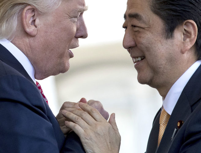 PRESIDENT DONALD TRUMP welcomes Japanese Prime Minister Shinzo Abe outside the West Wing of the White House on Friday. (AP Photo/Andrew Harnik)