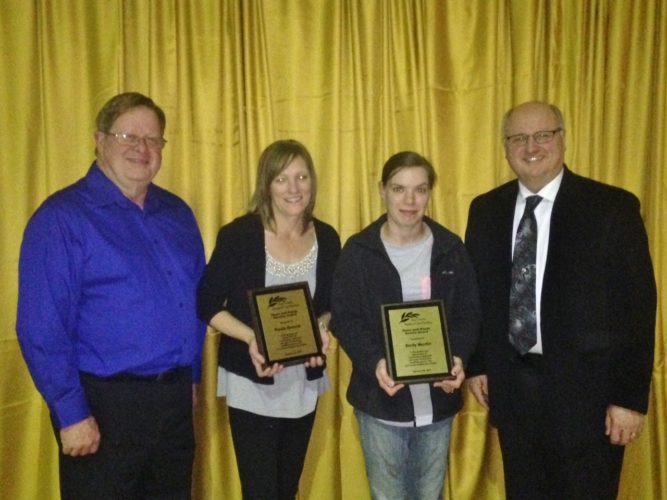 THE HEARTS AND Hands awards were presented to two staff members of the Victorian Heights and Iron County Medical Care facilities. Shown here, from left, are Iron County Human Services Board Chairman James Dellies, Hearts and Hands award recipients Paula Krause and Emily Martin and Administrator Chester Pintarelli.