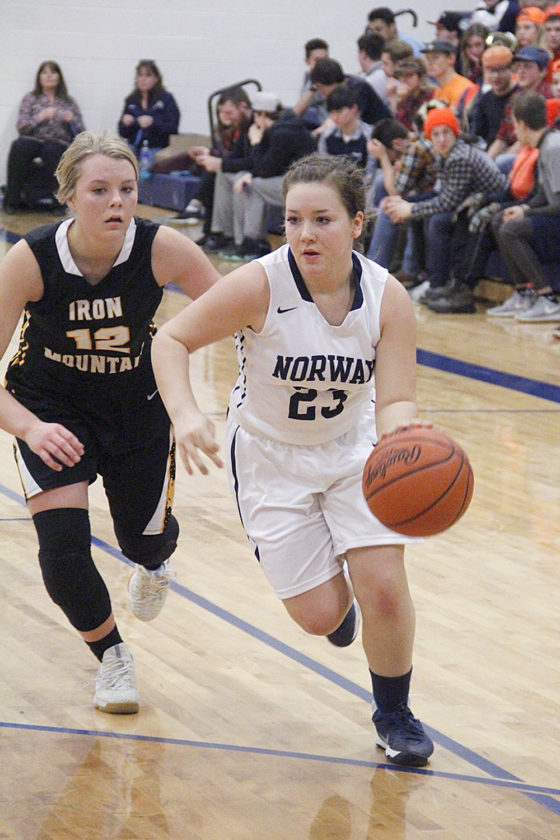 Norway's Jada Lasater, right, dribbles the ball against Iron Mountain's Saylor Swartout in a Mid-Peninsula Conference game on Wednesday in Norway. (Adam Niemi/The Daily News)