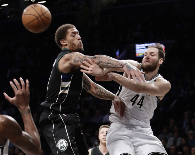 Brooklyn Nets' Bojan Bogdanovic (44) passes away from Milwaukee Bucks' Michael Beasley (9) during the second half of an NBA basketball game, Wednesday, Feb. 15, 2017, in New York. The Bucks won 129-125. (AP Photo/Frank Franklin II)