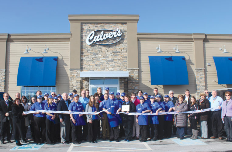 A RIBBON CUTTING ceremony marked the opening of the new Culver's restaurant in Iron Mountain attended by employees and ambassadors with the Dickinson Area Chamber Alliance. Shown here from left are Jon Pryor, Bill Jensen, Tamara Juul, Teresa Schettler, Regina Freudinger, Larry Lambert, Maureen Klose, Brandon Smith, Danielle Meise, Corky DeRoeck, Miranda Smith, Becca Oger, Craig C. Culver, Travis Vandenbrink, Jeremy Zawada, Hanna Ahrendts, George Neimi, Joe Zawada Jr., Ann Neimi, Ronda Zawada, Joe Zawada Sr., Michael Sexton, Bill Hall, Karl Modlowski, Brandon Wallace, Vernon Wallace, Betesy Hall, Susie Hall, Haley Yaniskivis, Jessica Haraski, Felicia Hehn, Heather Weinhart, Ginger Werth, Robert Whitens, Mercedes Degnaer, Scott Furlow, Sally Blom, Ryan Pepin, Erica Labre, Julie Olson, Ray King, Joe Testolin and Lynda Zanon, chamber director