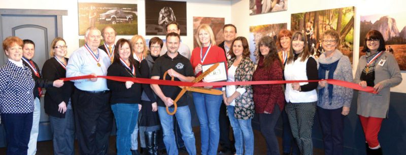 ATTENDING THE RIBBON-CUTTING ceremony at The Gallery in the Midtown Mall in Iron Mountain were ambassadors with the Dickinson Area Chamber Alliance. Shown from left are Lynda Zanon, Ben Ryan, Regina Freudinger, Joe Testolin, John Pryor, Tamara Juul, Donna Rahoi, Theresa Caylor, Carl Caylor, Steve Roell, Suzanne Anderson, Larry Lambert, Jessica Swenski, Lori Peterson, Chris Hanley, Karen Mooney, Sharon Danielson and Teresa Schettler.
