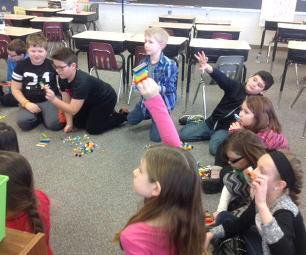North Elementary School of the Arts third graders, from left, Keegan Cox, Parker Summerfield, Eli Rigdon, Jacob Carrion, Laina Shipley, Kiatalynn Yoki, Ciara DeClark, and Madison Meise use Legos to understand how computer programs are written and run. The students are in Jodi Maycunich's class at North and instructed by Amanda Gibbons of the Iron Mountain Homeschool Partnership.