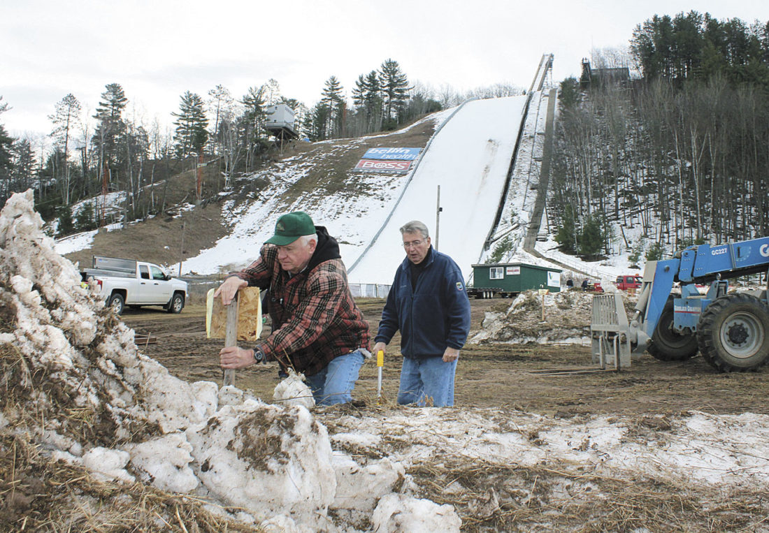 "LONG-TIME KIWANIS Ski Club members Joe ""Norton"" Anderson and Tom Bates of Kingsford mark parking spots at Pine Mountain for the 2017 Bellin Health Pine Mountain Continental Cup Ski Jumping Competition this weekend."