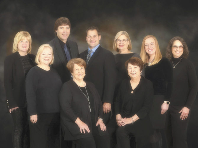 STEPHENS REAL ESTATE of Iron Mountain was the top real estate office in the area, according to the U.P. Association of Realtors' 2016 rankings. The staff includes, seated in front, from left, Sally Blom and Maddy Tousignant. In back, from left, are Jodi LaVarnway, Lynn Sawicky, Bob Norton, Ryan Gordon, Jo Poulin, Betsy Sawicky and Peggy Gingrass.