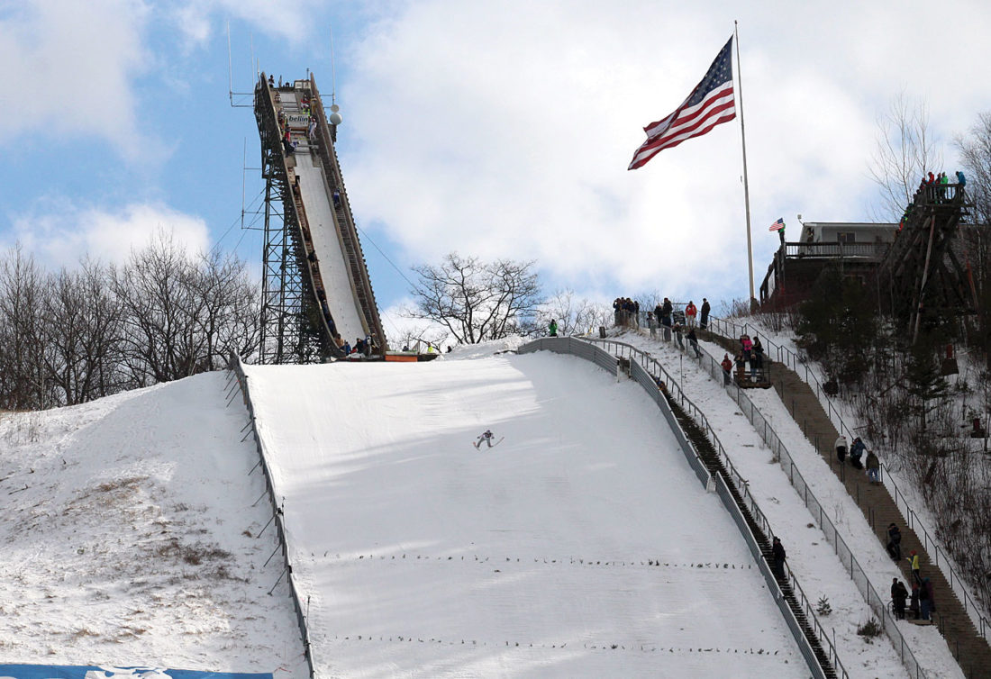 A skier descends down the Pine Mountain jump Sunday.