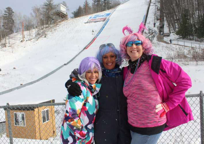 Brianna Track of Niagara, Gina Langsford of Iron Mountain and Debbie Payette of Iron Mountain enjoy the day at Pine Mountain on Saturday despite the jumps being cancelled because of high winds.