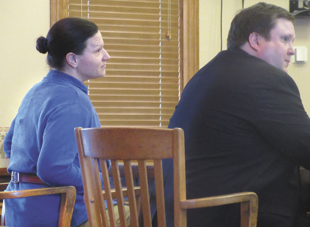KELLY COCHRAN, LEFT, and her defense attorney, Michael Scholke, listen as jurors confirm their votes after finding her guilty Tuesday of first-degree murder and four other charges in Iron County Trial Court. Cochran now faces life in prison without the possibility of parole when she is sentenced May 10. (Nikki Younk/Daily News photo)