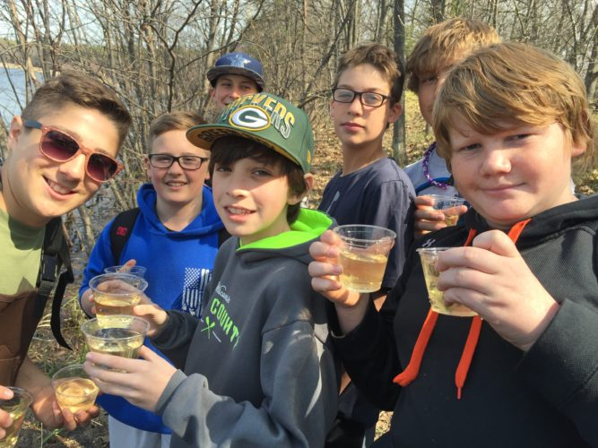 Students from an Iron Mountain science class taught by Rhonda Carey get ready to release the salmon they raised in their classroom through a Michigan Department of Natural Resources structured program, sponsored by Wildlife Unlimited of Dickinson County. Students care for and learn about the salmon life cycle in their classrooms, culminating with a release of salmon fry in the spring. Getting ready to release their salmon are, from left, Caleb Evosevich, Dominic Schinderle, Luke Powell, Eli Lofholm (in back), Joey Dumais, Blake Julian and Travis Mullikin.