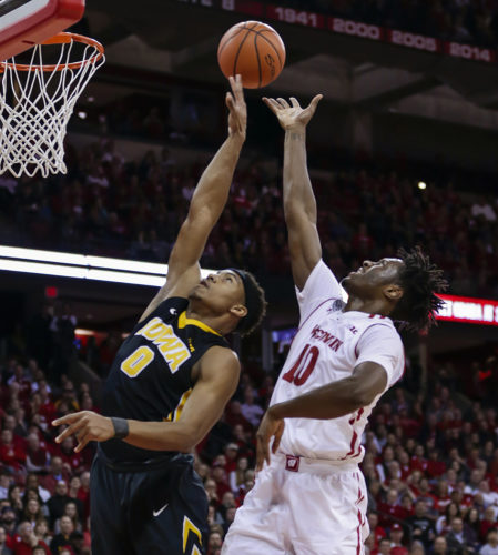 Iowa's Ahmad Wagner (0) tips a shoot away from Wisconsin's Nigel Hayes (10) on Thursday in Madison, Wis. Iowa won 59-57. (AP Photo/Andy Manis)
