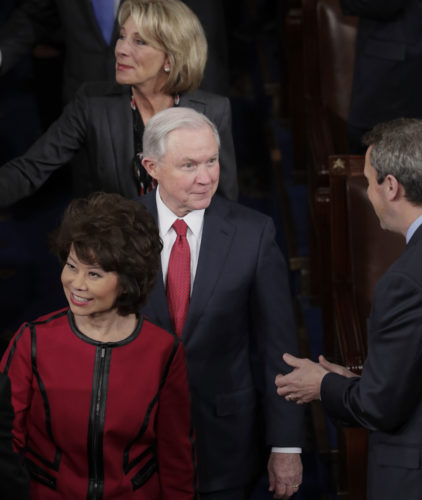 U.S. Attorney General Jeff Sessions, center, joins Transportation Secretary Elaine Chao and other Trump Cabinet members before President Donald Trump's address Tuesday. (AP Photo/J. Scott Applewhite)