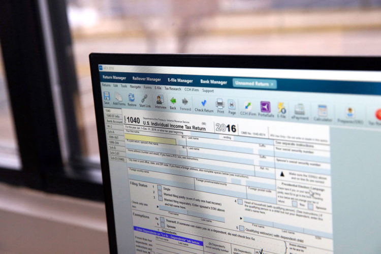 AN ONLINE TAX form is displayed on a computer at the offices of tax preparation firm as the deadline to file grows closer. Finding the cash to pay a larger-than-expected tax bill can be tricky, but tax pros say there are ways to deal with the surprise without having to pawn the family heirlooms.
