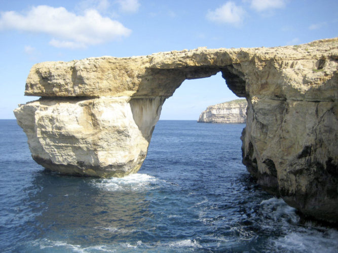 "An April 2014 image of the landmark the Azure Window located just off Malta. The natural rock arch jutting off the Maltese island of Gozo, has collapsed into the sea during a storm. Malta's prime minister called the loss of the iconic limestone formation ""heartbreaking."" No one was injured by the fallen arch, which was also a TV and film backdrop. Caroline Hodgson via AP"
