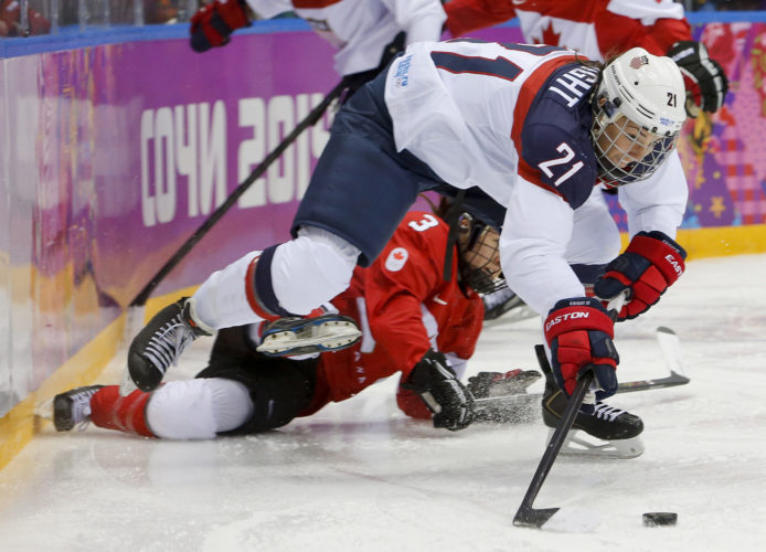 United States' Hilary Knight passes the puck against Canada during the Winter Olympics in 2014 in Sochi, Russia. The US women's hockey team threatened on Wednesday to boycott the upcoming world hockey championships over a wage dispute. (Mark Humphrey/AP File Photo)