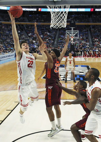Wisconsin forward Ethan Happ (22) goes to the basket against Virginia Tech forward Zach LeDay (32) during the second half of a first-round men's college basketball game in the NCAA Tournament, Thursday, March 16, 2017, in Buffalo, N.Y. Wisconsin won, 84-74. (AP Photo/Bill Wippert)