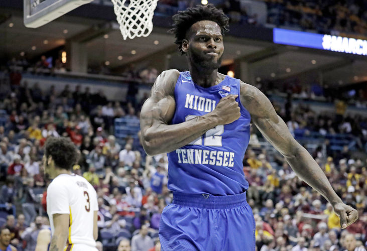 Middle Tennessee State's JaCorey Williams celebrates during the second half of an NCAA college basketball tournament first round game against Minnesota Thursday in Milwaukee. Middle Tennessee State won 81-72. (AP Photo/Morry Gash)