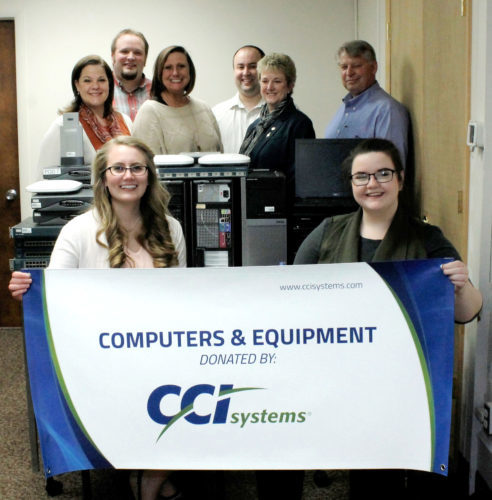 CCI SYSTEMS OF Iron Mountain has donated used computers and networking equipment to Michigan Technological University. In front, from left, accepting the donation are MTU students Sarah Clements and Alice Markham. In back, from left, are CCI Systems employees Michelle Copley, Evan Rice and Desiree Payant and MTU officials Dr. Jeffrey Wall, Dr. Mari Buche and Russ Louks