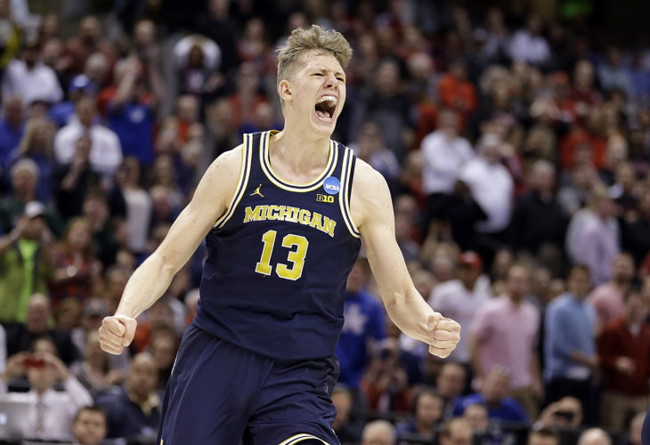 Michigan forward Moritz Wagner (13) celebrates a 73-69 win over Louisville in a second-round game in the NCAA tournament in Indianapolis on Sunday. (Michael Conroy/AP Photo)