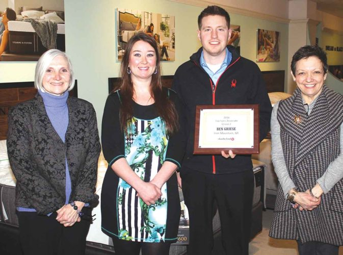 THE SALES TEAM at Slumberland Furniture in Iron Mountain was recognized with honors for the 2016 sales year. Shown here, from left, are Kathy Lewis and Jessica Meyer, who were on the list of top 10 sales associates for the region; Ben Griese, the top sales associate; and Paula Santoni, owner. Theresa Proudfit/Daily News Photo