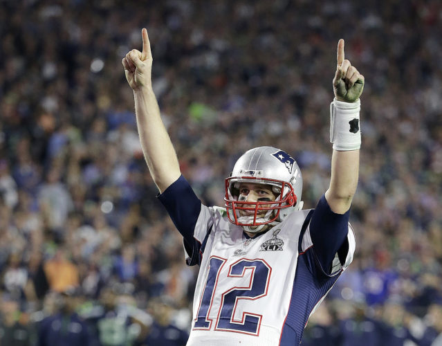 """Tom Brady's missing jersey from Super Bowls 49 and 51 were found in the possession of a member of the international media.  The NFL said in a statement on Monday that his jersey was found through the """"cooperation of the NFL and New England Patriots' security teams, the FBI and other law enforcement authorities."""" Brady said his jersey went missing after the Patriots' 34-28 win last month over the Atlanta Falcons.  The statement also said an ongoing investigation retrieved the jersey Brady wore in the Patriots' 2015 Super Bowl win against the Seahawks. (AP Photo/Kathy Willens, File)"""