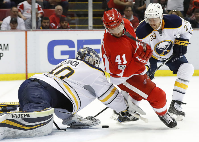 Buffalo Sabres goalie Robin Lehner (40) stops a shot as Detroit Red Wings center Luke Glendening (41) tries for a rebound in the second period Monday in Detroit. (AP Photo/Paul Sancya)