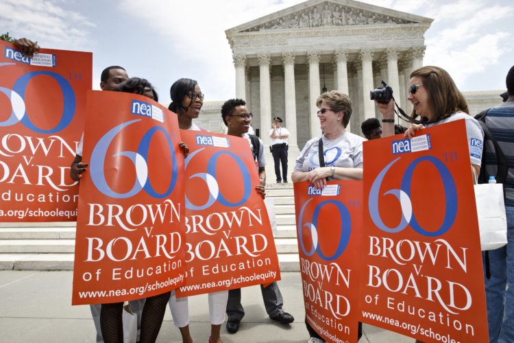 "AP Photo  NATIONAL EDUCATION ASSOCIATION staff members from Washington joining students, parents and educators at a May 13, 2014, rally at the Supreme Court in Washington on the 60th anniversary Brown v. Board of Education decision that struck down ""separate but equal"" laws that kept schools segregated."
