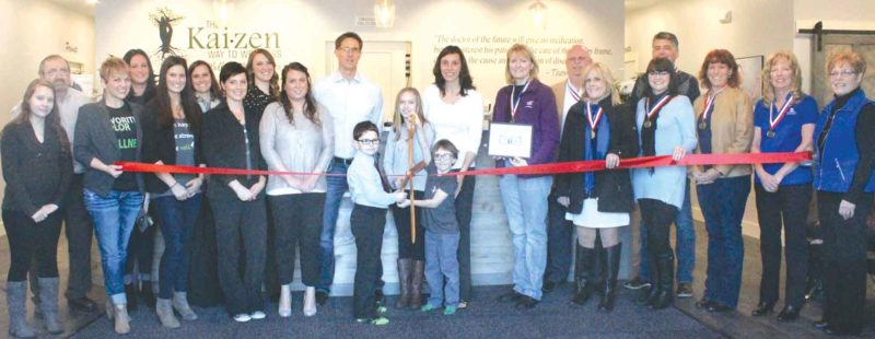 A RIBBON-CUTTING ceremony recently took place at the new Kaizen Way to Wellness office, 600 Carpenter Ave. in Iron Mountain. Ambassadors with the Dickinson Area Chamber Alliance were in attendance along with staff from the Kaizen office.  Shown here from left are Erica Labre, Ray King, Renee Stevenson, Kimberly Peot, Brianna Simoens, Shelby Morgan, Melody Bellmore, Cassie Morrison, Stacy Lutz, Tom, Alex, Madde, Sam and Laura Hemgren, Suzanne Anderson, Corky DeRoeck, Donna Rahoi, Teresa Schettler, Robert Whitens, Chris Hansley, Sandy Petroff and Lynda Zanon, chamber director. Theresa Proudfit/Daily News Photo