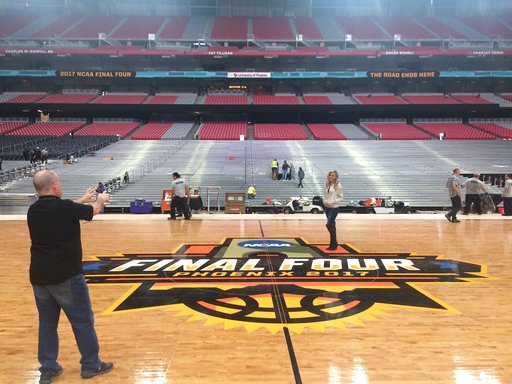 The floor for next weekend's NCAA men's college basketball tournament Final Four is laid in place Friday, March 24, 2017, at University of Phoenix Stadium in Glendale, Ariz. (AP Photo/Bob Baum)