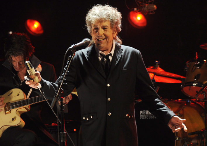 FILE - In this Jan. 12, 2012, file photo, Bob Dylan performs in Los Angeles. The Swedish Academy says 2016 Nobel literature winner Bob Dylan will meet with members of the academy this weekend and they will hand over his Nobel diploma and medal. (AP Photo/Chris Pizzello, File)