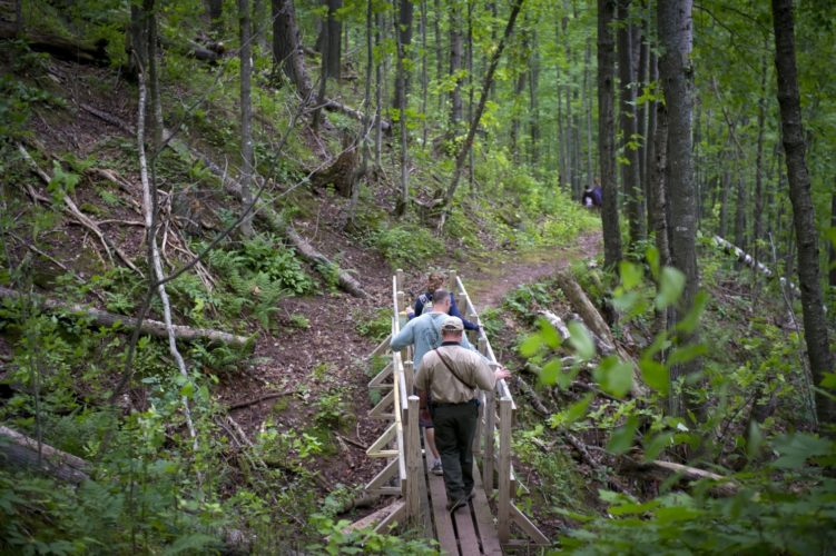 Many Department of Natural Resources hiking trails run through state parks, like this one in Porcupine Mountains Wilderness State Park in the western Upper Peninsula. Nearby campgrounds make these trails great weekend getaway destinations. Michigan DNR Photo