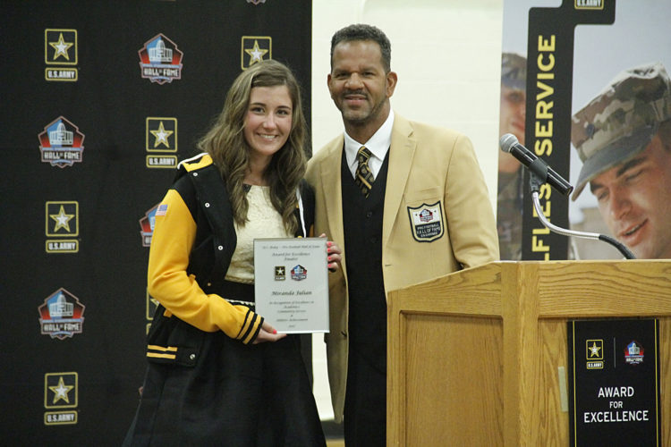 Iron Mountain High School junior Miranda Julian, left, poses with Pro Football Hall of Fame wide receiver Andre Reed during a recognition ceremony Monday in Iron Mountain. Julian was named one of 25 national finalists for the US Army Pro Football Hall of Fame?Award for Excellence. She will attend Enshrinement Weekend at the Pro Football Hall of Fame in Canton, Ohio in August, where the winner will be announced. (Adam Niemi/The Daily News)