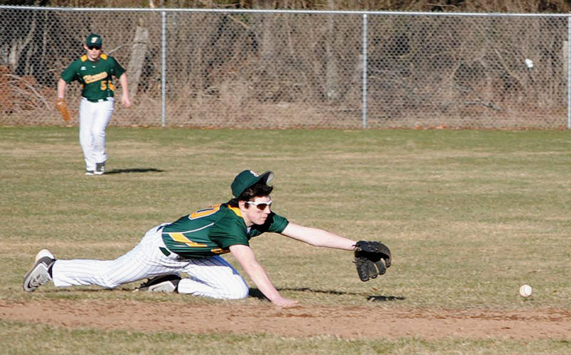 Florence shortstop Wes McLain dives for a ground ball as left fielder Mike Dishaw looks on during Thursday's Northern Lakes Conference baseball game at Red Johnson Field. Florence beat Crandon, 10-5. (Burt Angeli/The Daily News)