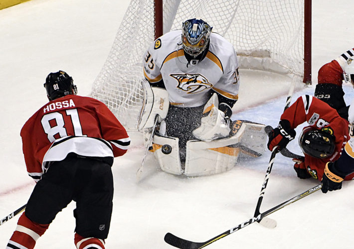 Nashville Predators goalie Pekka Rinne (35) makes a save on Chicago Blackhawks right wing Marian Hossa (81) during the third period in Game 2 of a first-round NHL hockey playoff series Saturday, April 15, 2017, in Chicago. The Predators won 5-0. (AP Photo/David Banks)