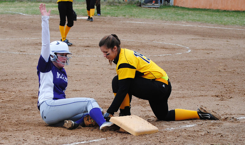 Niagara's Peyton Aderman, left, slides into third base in Monday's softball game at Northside Field. Mountaineers' Reighan Johnson applies the tag. (Burt Angeli/The Daily News)