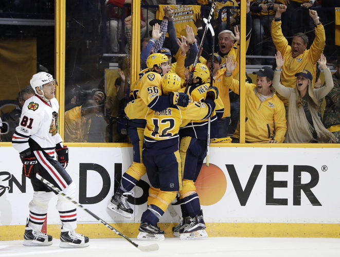 Chicago right wing Marian Hossa (81), of Slovakia, skates to the bench as Nashville Predators left wing Kevin Fiala (56), of Switzerland, celebrates with Mike Fisher (12) and James Neal, right, after Fiala scored the winning goal during overtime in Game 3 of a first-round playoff series Tuesday in Nashville, Tenn. The Predators won 3-2 to take a 3-0 lead in the series. (AP Photo/Mark Humphrey)