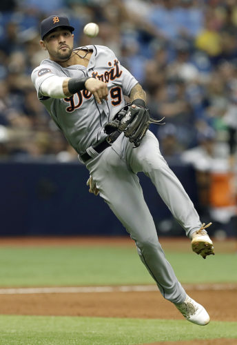 Detroit Tigers third baseman Nicholas Castellanos (9) leaves his feet as he throws out Tampa Bay Rays' Tim Beckham during the fifth inning Thursday in St. Petersburg, Fla. (AP Photo/Chris O'Meara)