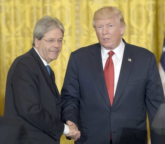 President Donald Trump, right, shakes hands with Italian Prime Minister Paolo Gentiloni, left, following their news conference in the East Room of the White House in Washington, Thursday. (AP Photo/Susan Walsh)