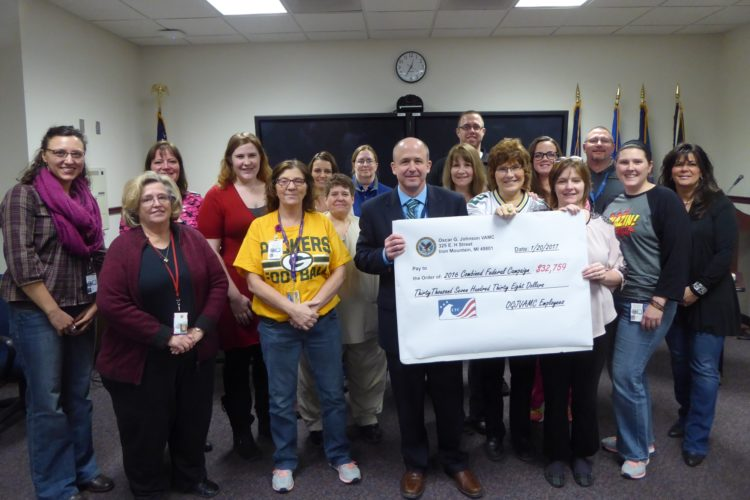 "The Oscar G. Johnson VA Medical Center raised $32,759 during the 2016 Combined Federal Campaign. Some of the CFC ""Key Person"" coordinators representing their departments are, from left, front row: Dayna Hodgins, Sue Bouchey-Hoffman, Patty Lancour, Barb Kirschner, medical center Director Jim Rice, Karla LaDuran, Ellen Thom, Audra Hawkins and Mary Deyaert; second row: Andria Nichols, Jeana Klingelhutz, Michelle Eaglebarger, Trish Bednarczk, Laura Skrumbellos, Tim Ellison, Amanda Winters and Mike Krasowski."