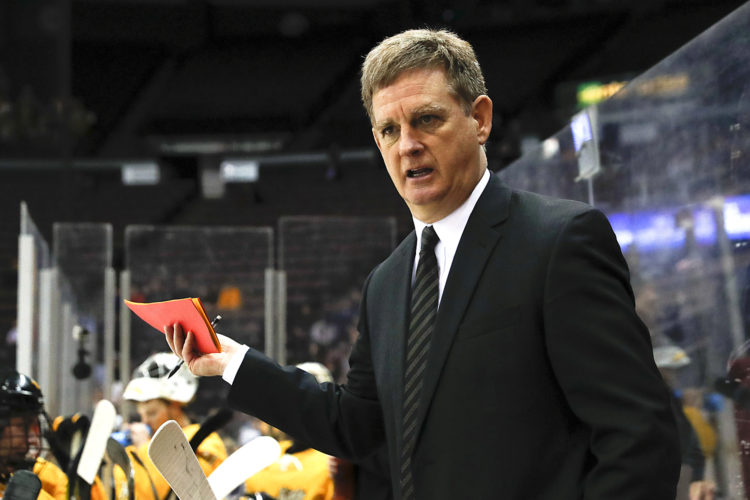 Michigan Tech head coach Mel Pearson works the bench during the first period in the regional semifinals of the college hockey tournament against Denver March 25 in Cincinnati. Pearson officially was named the new head coach at the Unviersity of Michigan on Monday. Michigan Tech officials said the search for a new coach has already begun. (John Minchillo/AP Photo)