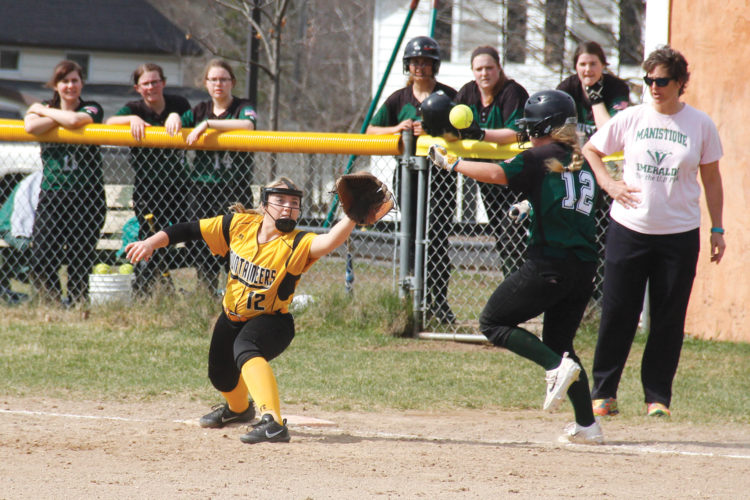 Manistique's Renee Schuetter, right, reaches first base safely as Iron Mountain first baseman Paige Fortner stretches to catch the throw on Tuesday in Iron Mountain. (Adam Niemi/Iron Mountain Daily News)