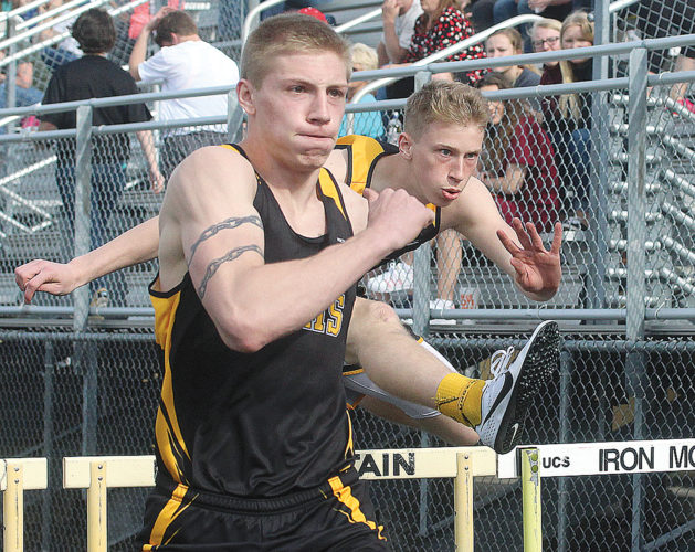 Iron Mountain's Aaron Bolo (left) and Charlie Gerhard ran one-two in the 110 hurdles Tuesday at Mountaineer Stadium. (Theresa Proudfit/The Daily News)